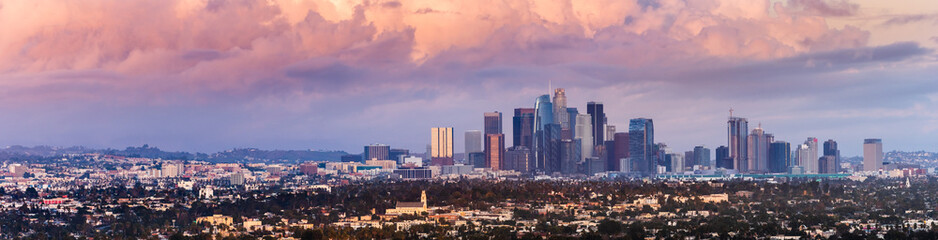 Panoramic view of downtown Los Angeles skyline at sunset, colorful storm clouds covering the sky; California