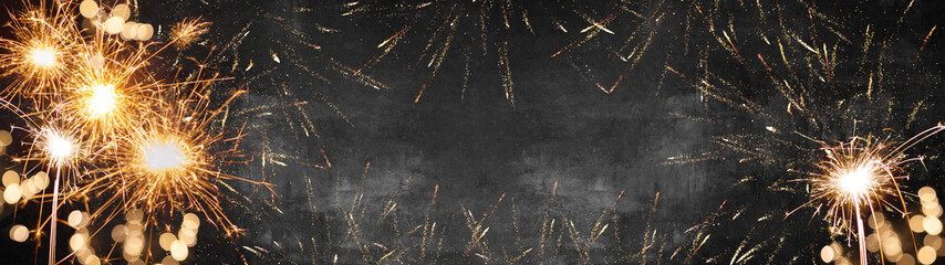Silvester background banner panorama long- firework on rustic dark black grey stone concrete texture, with space for text