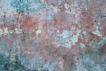 Creative abstract texture background. Beautiful turquoise, red and grey grunge rough artistic old stone wall with cracks and scratches. Copy space