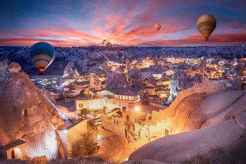 Beautiful scenes in Goreme national park. Colorful hot air balloons flying in the sky on sunset. Incredible rock formations in the valley Cappadocia, Turkey