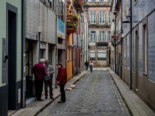 Porto, Portugal. 16 November 2019. Elderly men talking in the street.