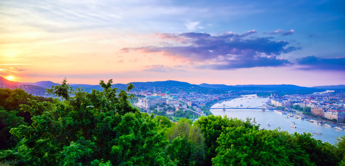 A view along the Danube River of Budapest, Hungary from Gellert Hill at sunset.