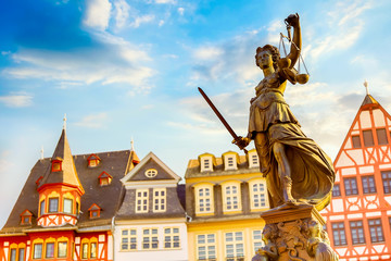Old town square Romerberg with Justitia statue in Frankfurt Main, Germany with blue sky
