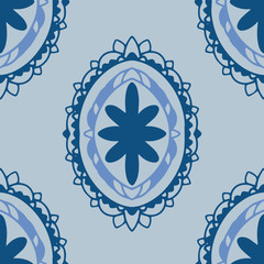 Oval motif seamless vector pattern in classic blue and coordinating colors. Interesting, hand drawn, three layer elements in popular classic blue and complementary colors.