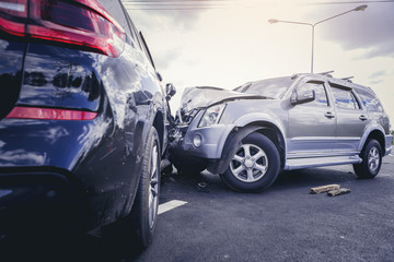Car crash dangerous accident on the road. SUV car crashing beside another one on the road..