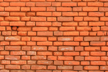 Old red brick wall, а background