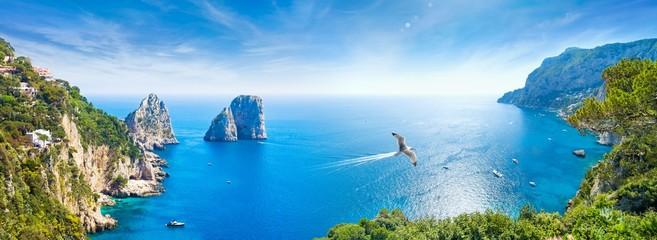 Panoramic collage with famous Faraglioni Rocks, Marina Piccola and Monte Solaro on Capri Island, Italy.