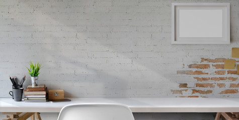 Top view of comfortable vintage workplace with office supplies and copy space on white table and brick wall