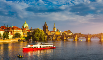 Charles Bridge in Prague in Czechia. Prague, Czech Republic. Charles Bridge (Karluv Most) and Old Town Tower. Vltava River and Charles Bridge. Concept of world travel, sightseeing and tourism.
