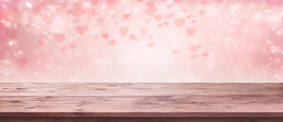 Flying pink hearts with wooden table
