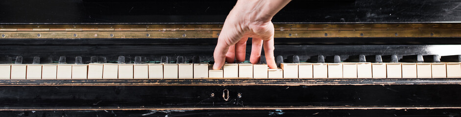 Female pianist hands playing on piano keyboard