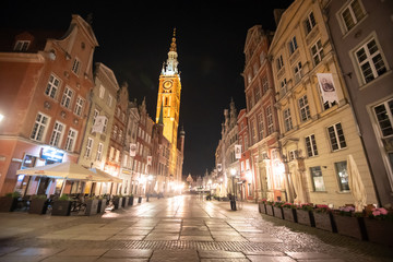 Gdansk, Poland - Juny, 2019. Beautiful historic houses and Golden Gate on Long Lane in Gdansk Old Town at night, Poland