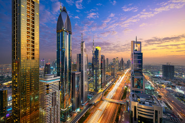 Aerial night view of the skyscrapers along the Sheikh Zayed Road in Dubai, UAE