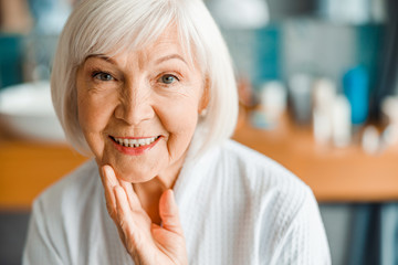 Lovely old woman looking at camera and smiling