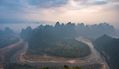 The mountains and river in the fog in Yangshuo, China