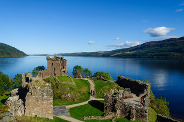 Ruins of Urquhart Castle on the shores of Loch Ness in the Scottish Highlands, with a beautiful blue sky in the summer. Drumnadrochit, Inverness, Scotland