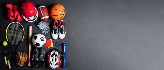 Variety Of Sports Equipment On Gray Background