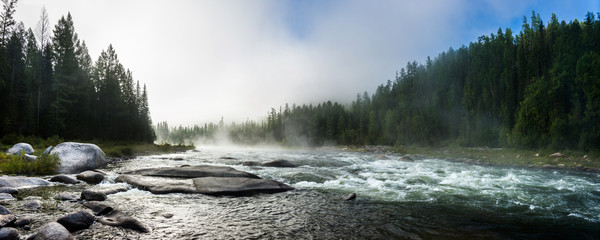 Siberian Balyiktyig hem river in Sayan mountains in early foggy morning.