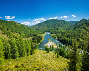 Summer siberian mountain landscape. Balyiktyig hem river and Sayan mountains covered by taiga forest in sunny day.