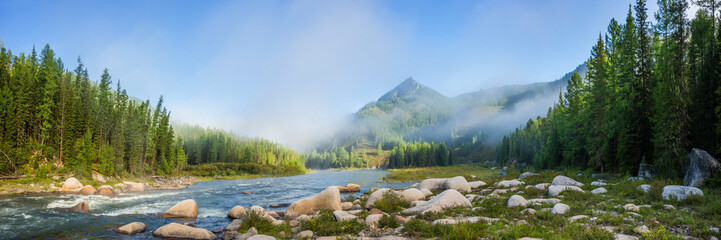 Siberian mountain Balyiktyig hem river in early foggy morning.