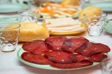 ham and cold cuts on a laid table
