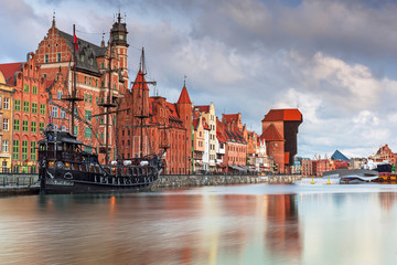 Beautiful scenery of the old town in Gdansk over Motlawa river at dawn, Poland.