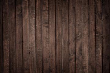 Textura de pranchas de madeira escura rústica envelhecida na vertical.