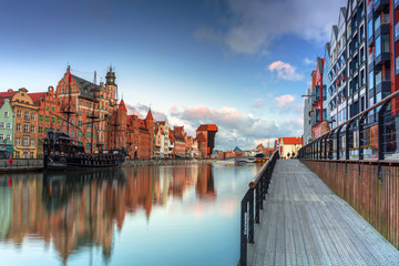 Beautiful scenery of the old town in Gdansk over Motlawa river at sunrise, Poland.
