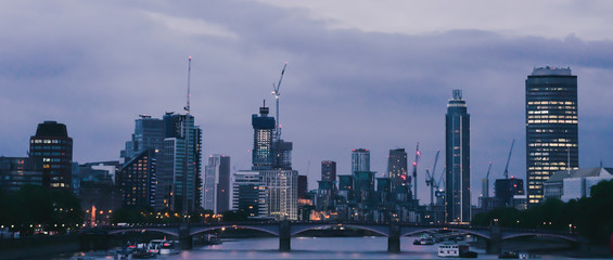 LONDON, UK , AUG 1, 2019, Panorama View from Westminster bridge at night, Thames skyline in City of london