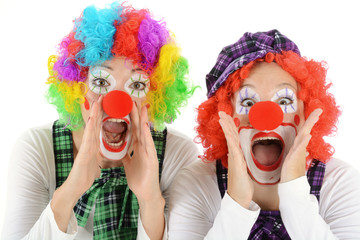 Women dressed in clown costume for carnival are silly and funny
