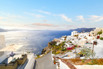 View of the Aegean Sea and Santorini caldera from a hillside overlook in Oia, Greece.