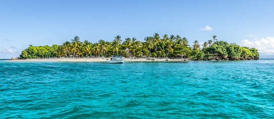 Cayo Levantado, Samana Bay, Dominican Republic. Panoramic view of Caribbean Islet with coconut palm trees and white sand beach.