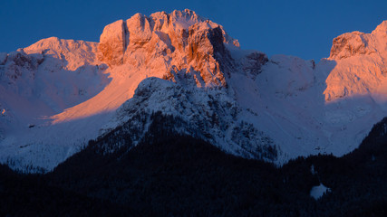 snow covered mountains during colourful sunset in the dolomiti