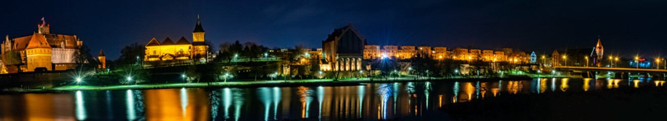 River Nogat and Malbork city by night - panoramic view - Malbork, Pomerania, Poland