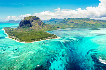 Aerial panoramic view of Mauritius island - Detail of Le Morne Brabant mountain with underwater waterfall perspective optic illusion - Wanderlust and travel concept with nature wonders on vivid filter