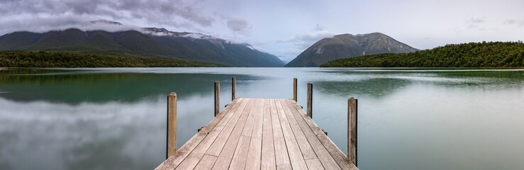 Landscape photo of a jetty on Lake Rotoiti, New Zealand. This jetty is within the  Nelson Lakes National Park and is one of the most Instagrammed locations in New Zealand
