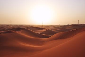 Sunrise in the red desert sand dunes of the Arabian Desert in Riyadh, Saudi Arabia