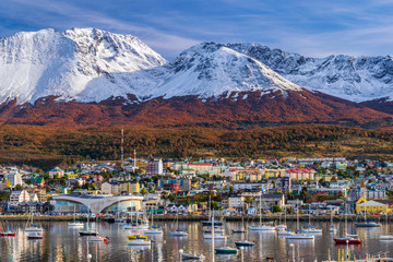 Colorful scene view of the bay and Ushuaia city against snow-capped Andes mountains during autumn season, Tierra del Fuego, Patagonia, Argentina