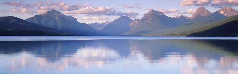 This is Lake McDonald. The surrounding mountains are reflected in the lake.