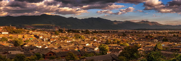 Panorama Top view scene of ancient LiJiang old town, is the historical center of Lijiang City, in Yunnan, China. It is a UNESCO World, culture and traditional, travel and tourist, holiday concept