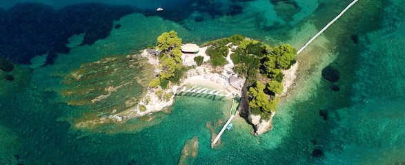 Aerial drone ultra wide photo of iconic small islet of Cameo near Laganas bay, Zakynthos island, Ionian, Greece