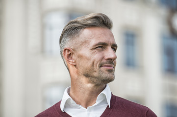 Facial care and ageing. Attractive mature man. Mature guy with grey hair and bristle outdoors. Men get more attractive with age. Hairdresser salon. Stylish hairstyle. Male face. Businessman concept