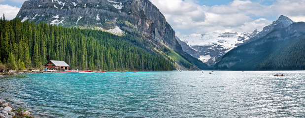 The beautiful turquoise glacial Lake Louise in Banff National Park. One of the most famous Canadian lakes