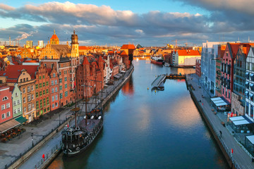 Aerial scenery of the old town in Gdansk over Motlawa river at sunrise, Poland.
