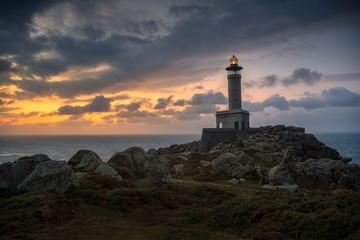 Punta Nariga lighthouse during a beautiful sunset with a dramatic sky. Malpica de Bergantiños, Galicia, Spain.