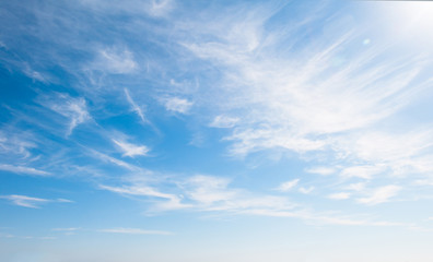 Blue sky with clouds over the horizon