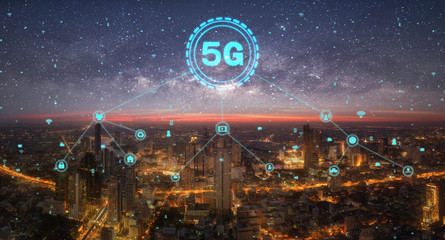 5G network digital hologram and internet of things on city background.5G network wireless systems.concept of high speed internet signal network