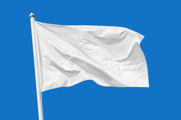 White flag waving in the wind on flagpole, isolated on blue background, closeup