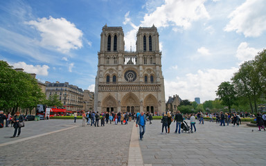 Paris, France - May 3, 2012: People at Notre Dame de Paris Cathedral in Paris, in France. Or Cathedral of Our Lady of Paris in English. It is one of the most known churches in the world