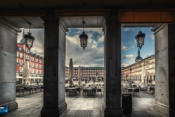Plaza Mayor seen through surrounding colonnade